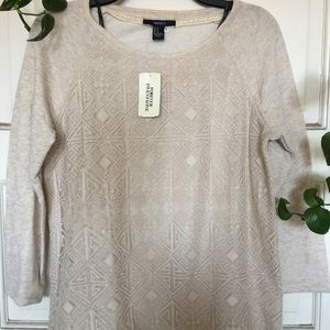 A brown long sleeve sweater